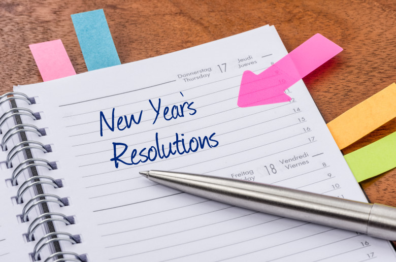 Daily planner with the entry New Years Resolutions, marketing plan